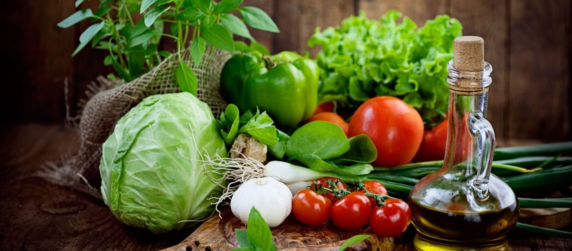 20752346 - fresh ingredients for cooking in rustic setting: tomatoes, basil, olive oil, garlic and onion,cabbage,letttuce