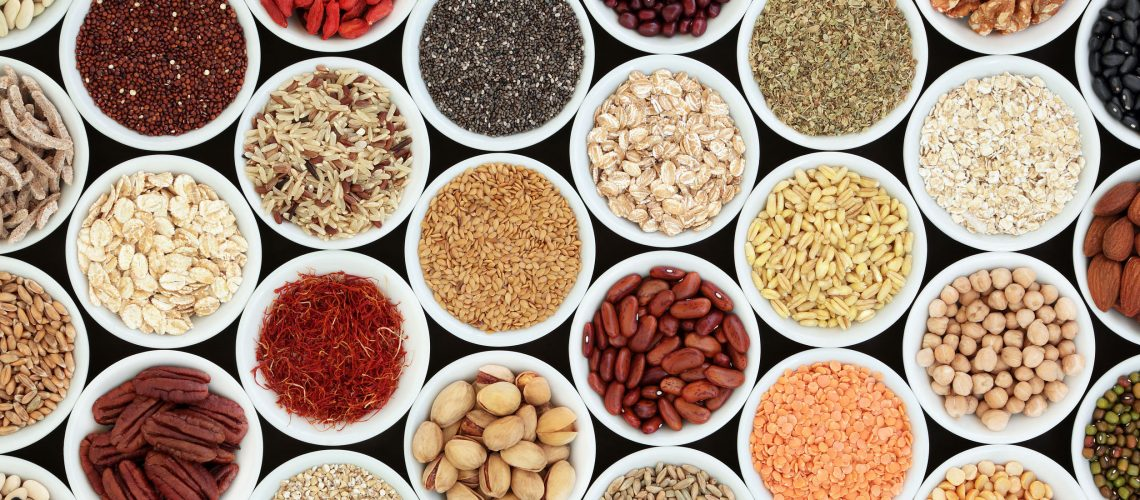 Dried high fiber health food with cereals, nuts, seeds, grain, fruit, spice and legumes with foods high in omega 3 fatty acid, antioxidants and vitamins, top view.