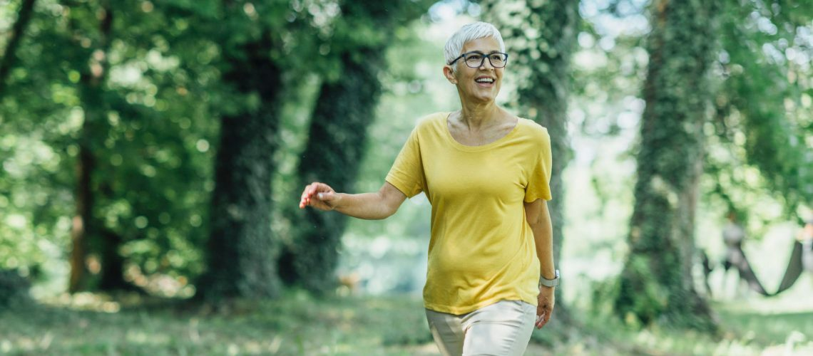 Intermittent walking workout, mature woman exercising, losing weight during menopause